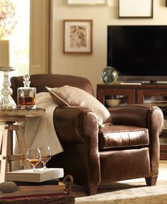 Manhattan Leather Club Chair = $1,500 , Recliner = $2,000 , Chair w/ Ottoman = $1,960 ... @ http://www.potterybarn.com/products/manhattan-leather-club-chair/?pkey=cleather-occasional-chairs