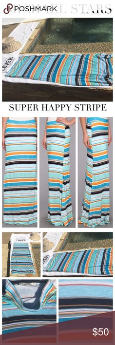 """Michael Stars Blue Super Happy Stripe Maxi Skirt Michael Stars Blue Super Happy Stripe Maxi Skirt tells you it's summer in this vibrant maxi skirt from Michael Stars. This semi-slim fitting, straight hem, maxi skirt is designed w playful stripes throughout & hugs curves for a stylish flair. Elasticized waistband lends a comfortable fit to allow for a slip-on design. Material: 100% Rayon. Made in the U.S.A. Size Small Approx Measurements: W: 28"""", Hips: 34"""", L: 40"""" Color: Super Happy…"""