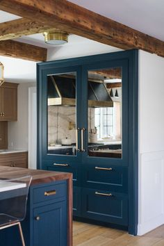 BECKI OWENS— Kitchen Design Inspiration: 3 Blue Beauties❤️. Benjamin Moore Newburg Green, brass hardware, Visual Comfort Morris Lantern and Siena Flush Mount, marble waterfall counter, butcher block, vintage rug, Jean Stoffer Design.