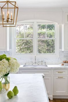 White Kitchen with Stacked Cabinets and Grey Island