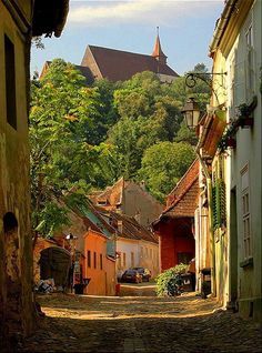 Sighișoara, Romania. Founded by German craftsmen and merchants known as the Saxons of Transylvania, Sighişoara is a fine example of a small, fortified medieval town which played an important strategic and commercial role on the fringes of central Europe for several centuries.