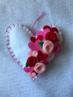 A personal favorite from my Etsy shop https://www.etsy.com/listing/571952344/valentines-felt-heart-ornament #feltornaments