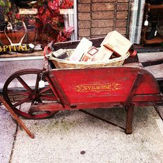 antique red wheelbarrow Ours needs repair and wasn't in excellent condition when we rescued it.