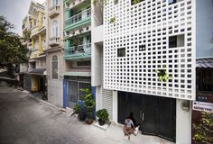 """Completed in 2015 in District 10, Vietnam. Images by LumKa Photography. The house is located in a dense residential alley at the heart area of District 10, Ho Chi Minh City (in Vietnamese is """"Quận 10"""" that's why the house..."""