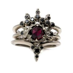 Blood Moon Gothic Engagement Ring Set - Rose Cut Garnet with Black Diamond Side Bands - Triple Moon Goddess I love the unexpected shapes that the wedding bands create centered around a nontraditional 3 stone engagement ring. The engagement ring is a tripl Champagne Engagement Rings, Gothic Engagement Ring, Black Diamond Engagement, 3 Stone Engagement Rings, Engagement Ring Settings, Nontraditional Engagement Rings, Engagement Photos, Black Diamond Wedding Rings, Engagement Bands