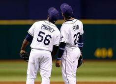 Pitcher Fernando Rodney #56 and infielder Carlos Pena #23 of the Tampa Bay Rays celebrate victory over the Toronto Blue Jays at Tropicana Field on September 22, 2012 in St. Petersburg, Florida.
