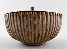 Arne Bang. Ceramic vase with bronze lid. Stamped AB 115. Beautiful glaze in green and brown shades. 13.5 x 10 cm.