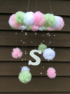 pom pom baby mobile with initial baby mobile by JennabooBoutique