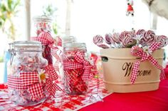 Love the look of these jars with the gingham ribbon and the daisy in the middle!