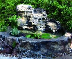 An amazing selection of personal waterfalls and fountains for your backyard makeover, including cascading water features and self-contained outdoor waterfall ponds. Patio Pond, Pond Landscaping, Ponds Backyard, Garden Pond, Landscaping With Rocks, Backyard Waterfalls, Swimming Pool Waterfall, Pond Waterfall, Pond Kits