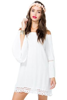 BOUTIQUE FIVE  A crepe woven shift dress featuring an elasticized off-shoulder neck and crochet trimming. Long sleeves. Finished hem. Unlined. $35.90