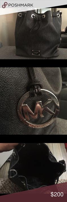 Black Michael Kors like New Authentic Purse Black Michael Kors like New Authentic Purse, guaranteed Authentic still have bag it came in. No stains lightly worn on the silver part shown. Paid 450$ I will make sure I give the Michael Kors drawstring bag it came in as well. Michael Kors Bags Shoulder Bags