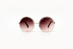 Óculos redondo com lente dedradê