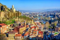 Tbilisi Old Town, Georgria. Panoramic view of Tbilisi Old Town with Narikala For , Origin Of Christianity, Travel Website Design, Group Tours, World Heritage Sites, Old Town, San Francisco Skyline, Adventure Travel, Paris Skyline, Georgia