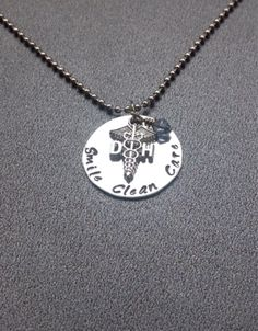 A personal favorite from my Etsy shop https://www.etsy.com/listing/205851692/hand-stamped-dentist-jewelry-with-smile