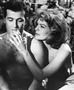 Illya (Melina Mercouri) trying to infuse confidence on a client (an inexperienced sailor) in 'Never on Sunday' Tarzan Johnny Weissmuller, Never On Sunday, Die A, Dorothy Lamour, Weegee, Greek Beauty, Greek Culture, Music Photo, Famous Women