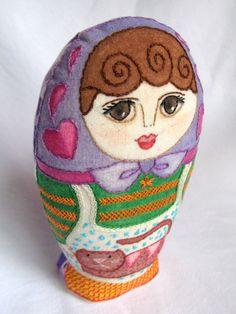 Merci  matrioska pintada y bordada por Gineceo en Etsy, $53.00 Embroidered matryoshka doll.