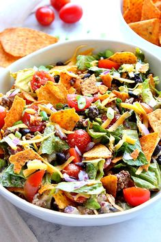 Dorito Taco Salad Recipe - chopped lettuce tomatoes seasoned meat black beans onions zesty dressing and crunchy tortilla chips is everything you love about tacos in one tasty salad! Chopped Salad Recipes, Taco Salad Recipes, Vegetarian Salad Recipes, Salad Recipes For Dinner, Dinner Salads, Healthy Recipes, Easy Recipes, Mexican Salads, Mexican Food Recipes