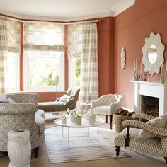 Terracotta living room with patterned fabric | Living room decorating ideas | housetohome.co.uk. Anyone know where the curtains came from????