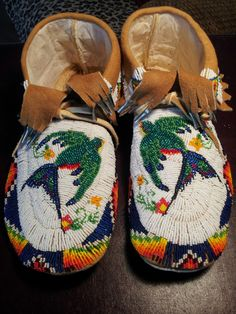 Size 14 moccasins, made with size 11 cut beads On thick deer hide.