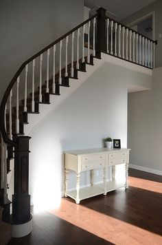 Simplify: The house-house Walnut stain and Swiss Coffee- stairs  Paint: Aloof Gray by Sherwin Williams