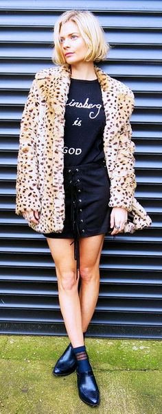 Black lace-up skirt and graphic sweater with a fuzzy animal-print coat