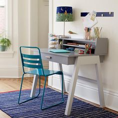 """With a unique two-tone construction, our Division Desk is a piece of kids' furniture unlike any other. Featuring a zinc drawer pull with brushed silver accents, it's stylish enough to go anywhere in your house. And the smooth rolling metal drawer glides give little ones easy access. Add the removable hutch (sold separately) and create even more space for books, folders and more.<br><br>Shop our collection of exclusive <a href=""""/kids-desk-chairs/kids-furniture/1"""" title=""""desk"""" chairs""""="""""""">desk…"""