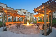 Beautiful Apartments Community Fire Pit With Trellis And String Lights