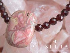 Rhodochrosite pendant in Garnet beaded necklace on Rose Quartz background Gems Jewelry, Beaded Jewelry, Beaded Necklace, Gem S, Crystal Healing, Gemstone Beads, Rose Quartz, Garnet, Gemstones