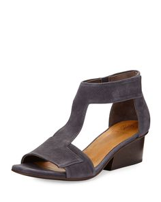 "Coclico textured leather city sandal. 1.5"" wooden heel. Open toe. T-strap vamp. Adjustable ankle cuff. Grip-strap closure. Cushioned insole. Leather outsole. ""Ollie"" is made in Spain."
