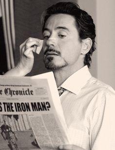 Grooming Robert Downey Jr in white custom dress shirt.