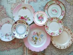 Beautifully grouped vintage plates.  Love Love this!--I want to know how they get the layered part of the plates hung?