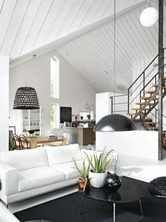 White can open up a room dramatically, a perfect example is this picture with a beautiful open plan living with loft ceilings Home Living Room, Living Spaces, Style Loft, Swedish House, Open Plan Living, Clean Living, Scandinavian Home, Home And Deco, Home Fashion