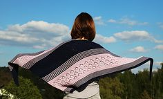 This is my first design. It is an asymmetrical shawl. The shawl is cast on at one edge and is knitted sideways. It is a pretty light shawl for spring. You can use any yarn, however, it will change the size of your shawl. Pattern is all written out. There are no charts.