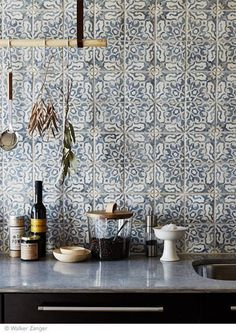 Mediterranean style kitchen with funky tiles.