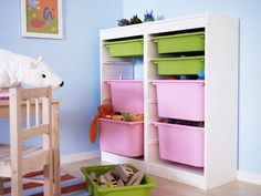 this toy storage is from ikea. I am digging the white with pale pink and green bins. Very soft and feminine. Picture is from ohdeedoh.com Ikea Storage Bins, Toy Room Storage, Ikea Cubbies, Toy Storage Solutions, Kids Storage, Storage Design, Storage Ideas, Storage Baskets, Toy Rooms