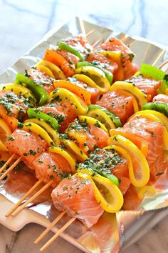 Enjoy warmer temperatures by firing up your grill and making these super Easy Salmon Kebabs - healthy, fast, so delicious! Enjoy warmer temperatures by firing up your grill and making these super Easy Salmon Kebabs - healthy, fast, so delicious! Kabob Recipes, Grilling Recipes, Fish Recipes, Seafood Recipes, Dinner Recipes, Cooking Recipes, Healthy Recipes, Dinner Ideas, Vegetarian Food