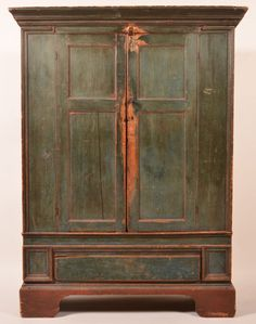 """Early 19th Century Maryland or Virginia Painted Softwood Two Door Cupboard. Molded cornice, two double paneled doors, interior shelves and molded stiles. Above a full width lip molded dovetailed drawer, flanked by block molded stiles and molded bracket base. Original blue and red painted surface. Signed L. House on interior of doors. 74-1/4""""h. x 56""""w. x 20""""d."""