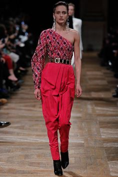 The one shoulder look paired with bold colors at Balmain. #pfw