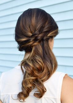 woven side swept ponytail with curly tips