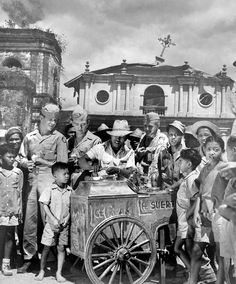 Pateros (Southeast Metro Manila), celebrating the 1st year anniversary since the liberation of the village from Japanese occupation of WWII, Philippines,1946.  War torn Pateros Church or San Roque Parish Church can be seen behind. by John T Pilot, via Flickr
