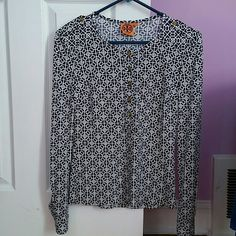 Tory Burch blouse.. Blue and white color..size Xs can fits even S.. has tory burch logo all over..golden buttons on the sleeves and shoulders.. great conditions.. no damage.. Tory Burch Tops Blouses