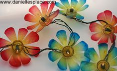 DIY Recycled water bottle flower patio lights. These are the bottoms of used water bottles.  CUTE!