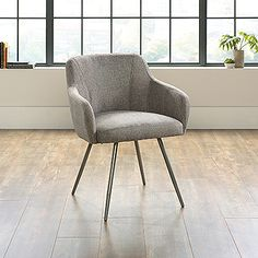 Kick back in this cool and contemporary occasional chair by Sauder. Class up any room with its chic gray design and stylish steel legs. Made with durable fabric and modeled for comfort, this chair is the perfect statement piece for any room or setting. Durable fabric seating surface. Steel legs. Color: Gray.