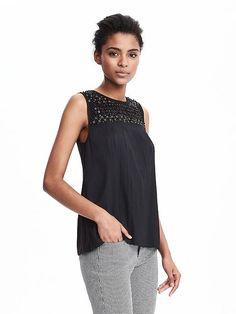 Embellished sleeveless blouse.  No necklace needed.