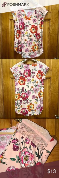 ✨ Express   floral top Floral comfy short sleeve blouse from Express basically new without tags. Soft satin material ✨ Get this with 5 other items with my 6 for $25 special in my closet! Express Tops