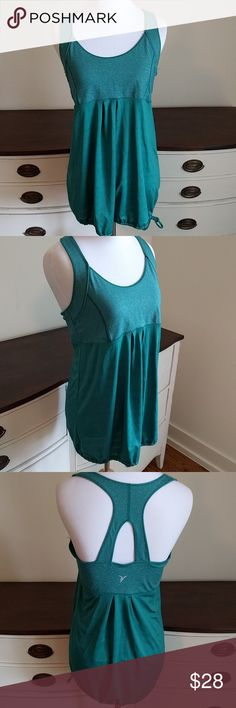 Gorgeous green workout top NWOT this is a very unique shade of green, built in shelf bra, draw string bottom allows you to wear shorter or longer. Old Navy Tops