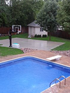 In the background you can see his Pro Dunk Silver Basketball System on the concrete slab half court. At the bottom there is his pretty swimming pool.