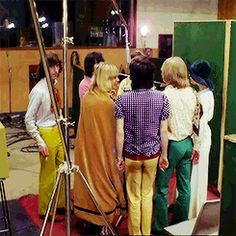 The Rolling Stones and friends recording the vocals for Sympathy for the devil