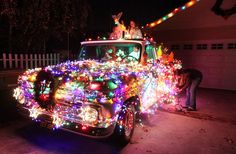 "Christmas Time Around the World - In Focus - The Atlantic  Adriana Leiss and her daughters Gabriella and Amelia replace burned out light bulbs on their 1965 Chevy pick-up truck decorated for Christmas at their house, on what is known as ""Candy Cane Lane"" in the Woodland Hills section of Los Angeles, on December 9, 2012. (AP Photo/Richard Vogel)"